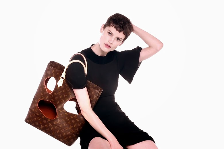 Rei Kawakubo deconstructed the bag, put holes in and hereby shows the inner lining.